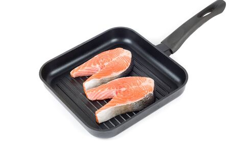 trout steak at grill pan on a white background photo