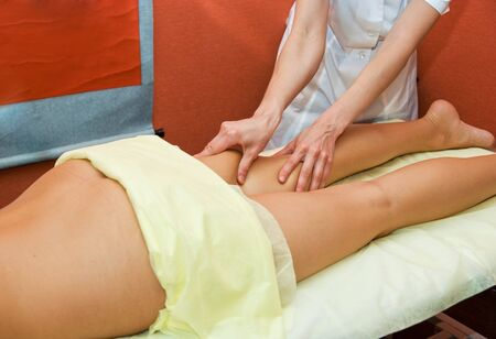 Closeup of woman hand with professional massage photo