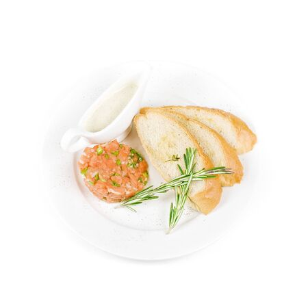Tar-tar from salmon fish with green onion. Served with honey sauce and white bread toast. photo