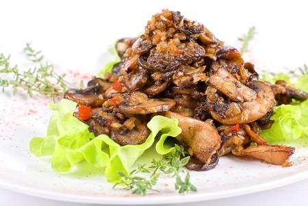 Roasted mushrooms salad isolated on a white background Stock Photo