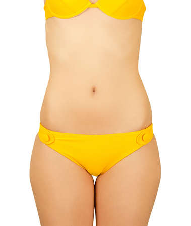 Girl at yellow bikini closeup isolated on a white photo