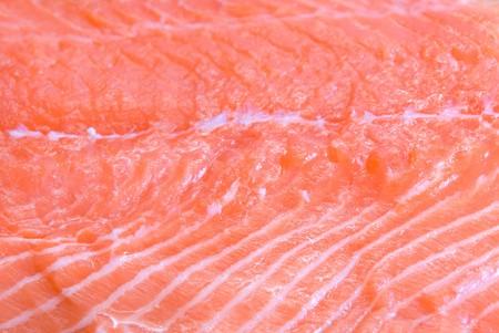 salmon closeup slice at wooden board photo