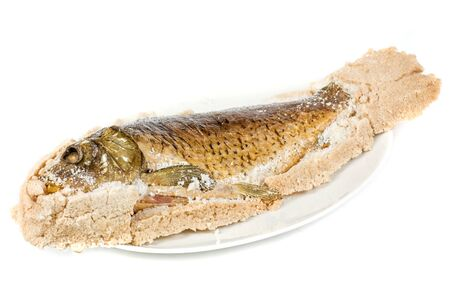 Fish carp baked with bay salt closeup photo