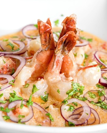 person appetizer: King shrimps with vegetables at cream sauce Stock Photo