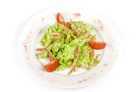 Salad of squid with roast chicken meat, apples, tomatoes, eggs and peppers photo