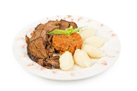 delicate beef fillet roasted with herbs - thyme, rosemary,clary, with potato and vegetable paste photo