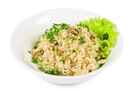 risotto with seafood isolated on a white photo