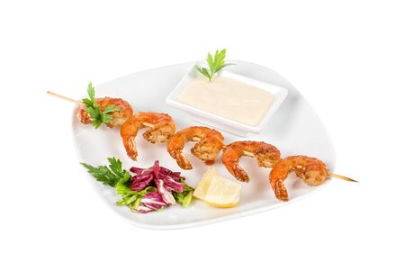 Fried kebab of shrimps with vegetables and sauce photo