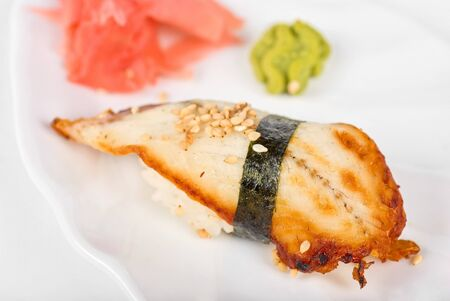 unagi sushi of eel with ginger, seaweed and sesame photo