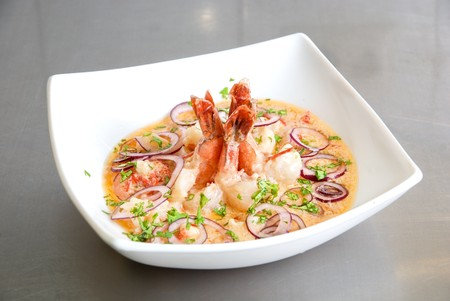 King shrimps with vegetables at cream sauce photo