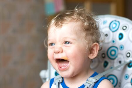 Messy smiling baby boy after eating Stock Photo - 7096006