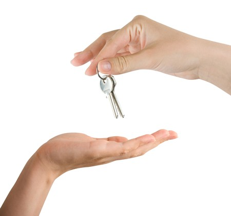 Human hands and key isolated on white background Stock Photo