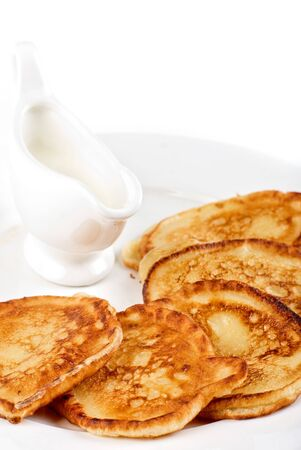 thick pancake with sauce on a white photo