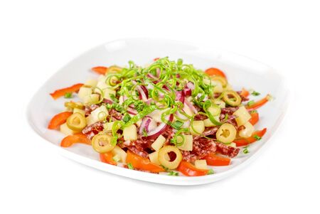 salad from salami, vegetables and olives photo