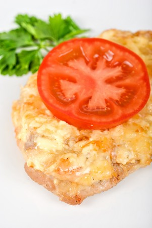 Roasted pork steak baked with cheese and tomato photo