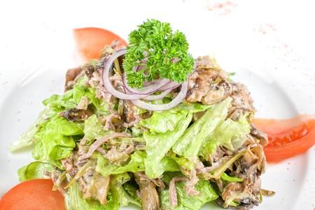 Mushrooms assortment fresh salad closeup at plate photo