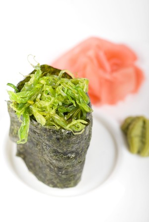 Japanese fresh maki sushi with green seaweed photo