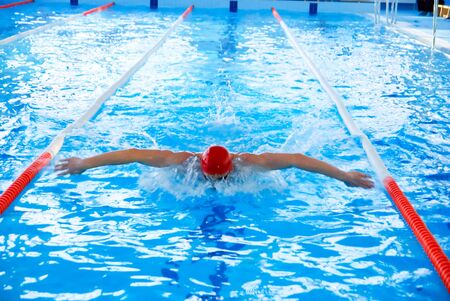 Athletic man swimming in the pool photo