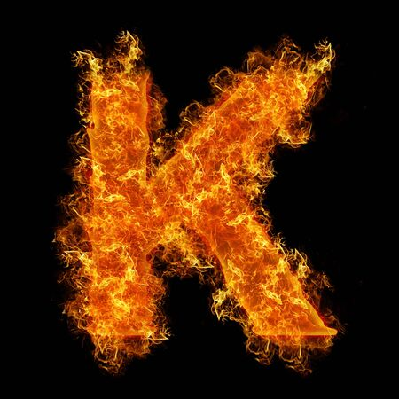Fire letter K on a black background photo
