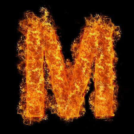 Fire letter M on a black background photo