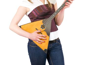 balalaika at girl hands isolated on a white background photo