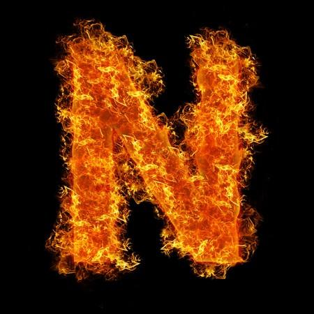 Feuer Buchstaben N auf schwarzem Hintergrund  Standard-Bild