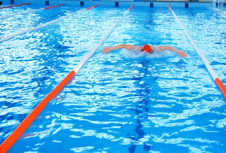 Athletic man swimming in the pool Stock Photo - 7234908