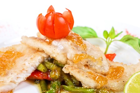 halibut filet roast at lime juice and vegetables photo