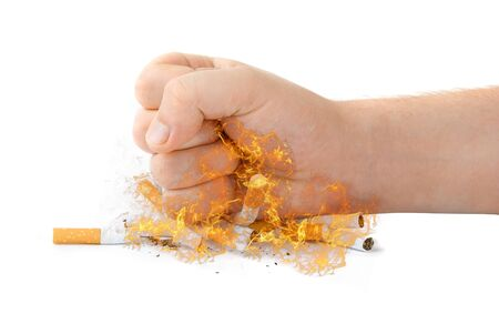 male fist with many cigarettes at fire isolated on white