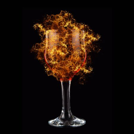 happy hours: red wine at fire on black background Stock Photo