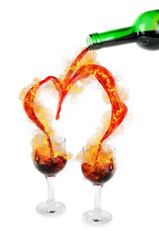 Heart from pouring red wine in goblets with fire photo