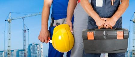 meter box: Los trabajadores diferentes hombre portarretrato en la creaci�n de fondo  Foto de archivo