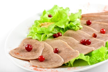 Beef tongue with cranberry isolated on a white background photo