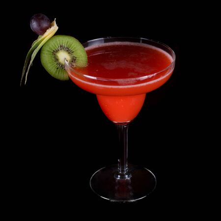 red cocktail with kiwi on a black background Stock Photo - 7383573