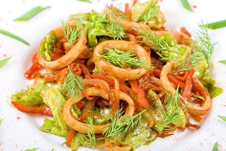 Seafood salad with squid and vegetables close up photo