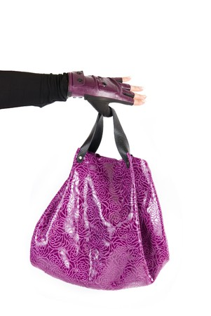 purple women bag at hand isolated on a white background photo