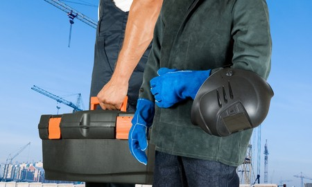 male welder closeup with welding equipment on building background Stock Photo - 7383596