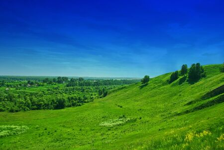 summer landscape of green valley and blue sky photo