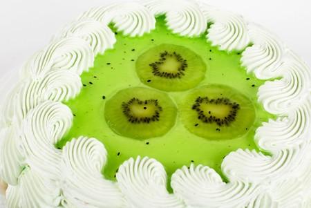 fruit kiwi cake closeup isolated on a white photo