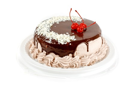 cake closeup with cherry isolated on a white Stock Photo - 7434223