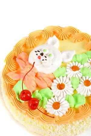 cream cake closeup with cherry on a grey photo