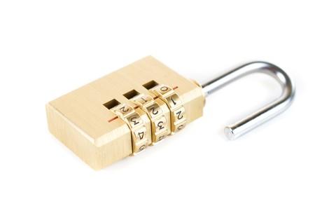 Close-up combination padlock isolated on white background photo
