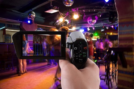Dancing people in an underground club recording by camcorder Stock Photo - 7471126