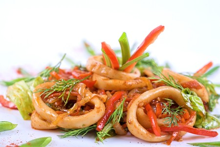 squids: Seafood salad with squid and vegetables closeup Stock Photo