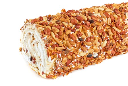 Nuts Swiss roll closeup isolated on a white background Stock Photo - 7496225
