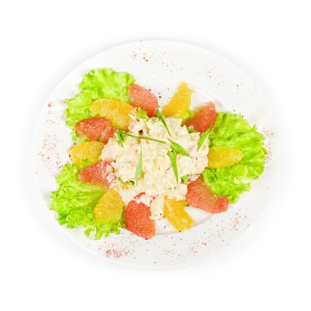 seafood salad of shrimp baked at cream with orange and grapefruit isolated on a white background photo