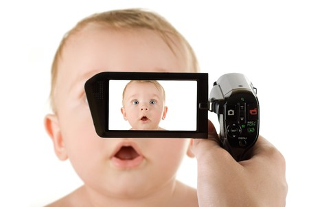 camcorder: baby boy portrait closeup isolated on a white background recording by camcorder Stock Photo