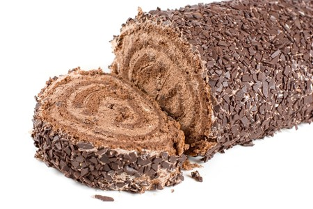 Chocolate Swiss roll closeup isolated on a white background photo