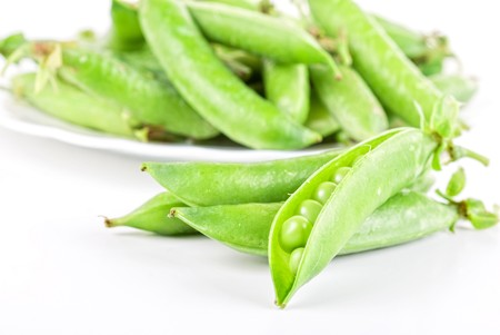 Ripe pea vegetable with green leaf isolated on white background Stock Photo - 7542296