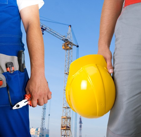 Different workers man closeup on building background Stock Photo
